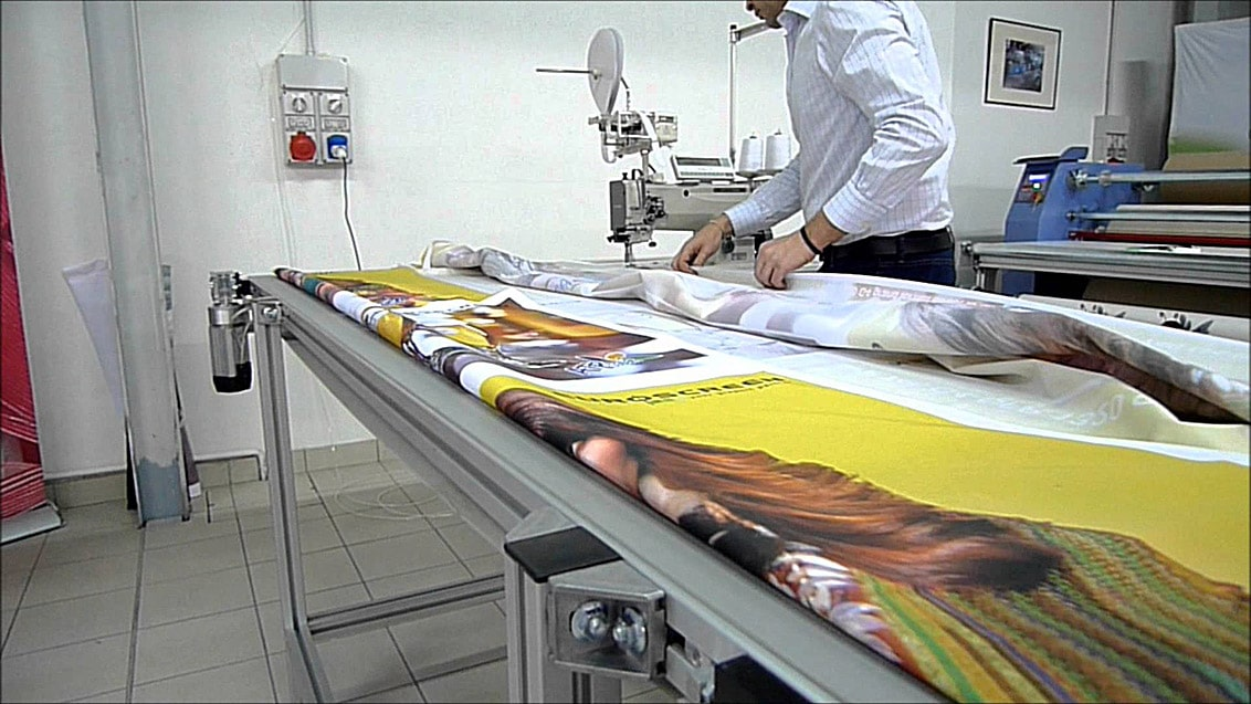 Sewing of advertising textiles